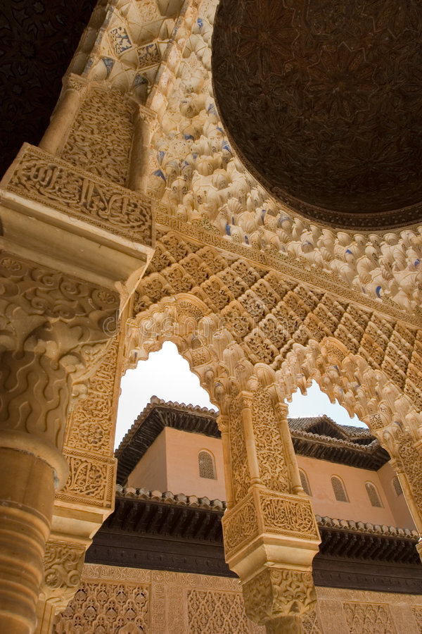 Column Roof detail in Alhambra. The celebrated Patio de los Leones (Court of the Lions) is an oblong court, 116 ft (35 m) in length by 66 ft (20 m) in width royalty free stock images