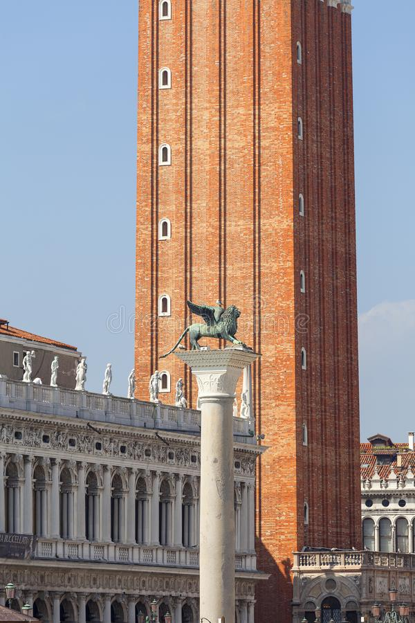 Column of San Marco and St Mark`s Campanile on Piazza San Marco, Venice, Italy stock image