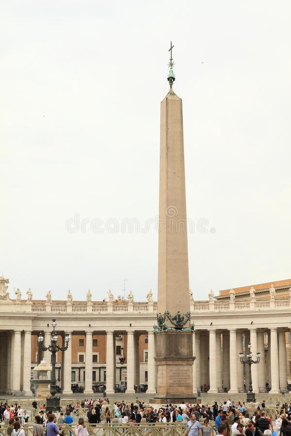 Column on St. Peter`s Square. Column with cross on St. Peter`s Square in Vatican City in Rome, Italy stock photography