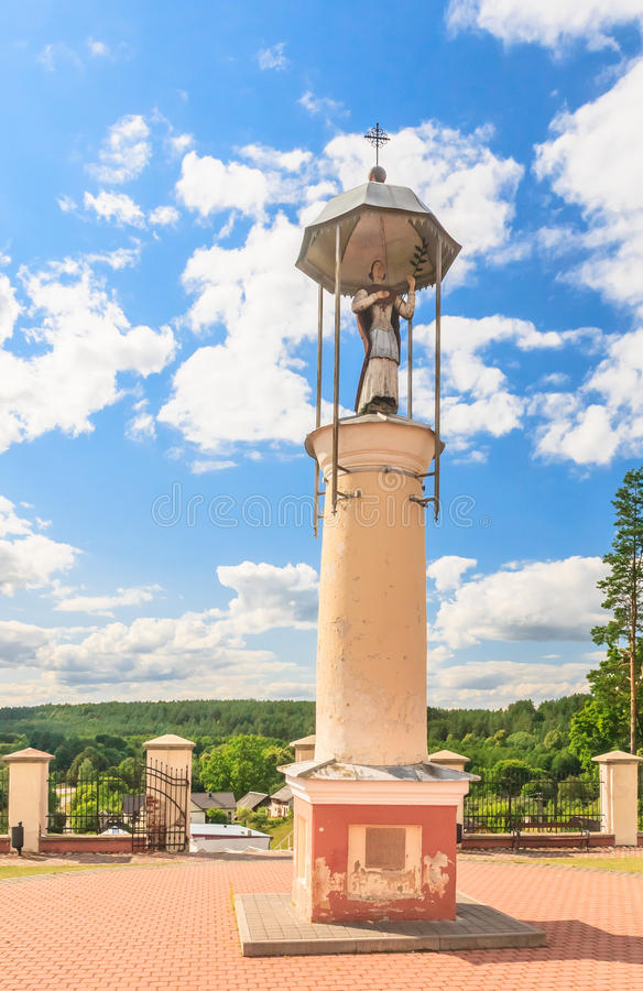 Column with a statue of Saint Agatha to the church. Liskiava. Lithuania royalty free stock images