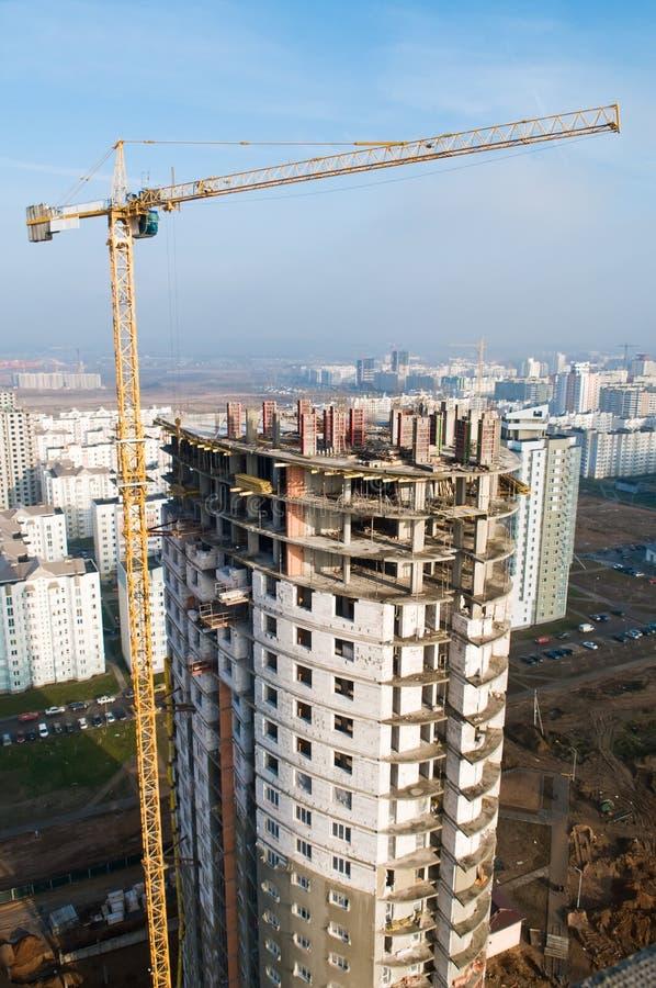 Column tower crane lifting load stock photography