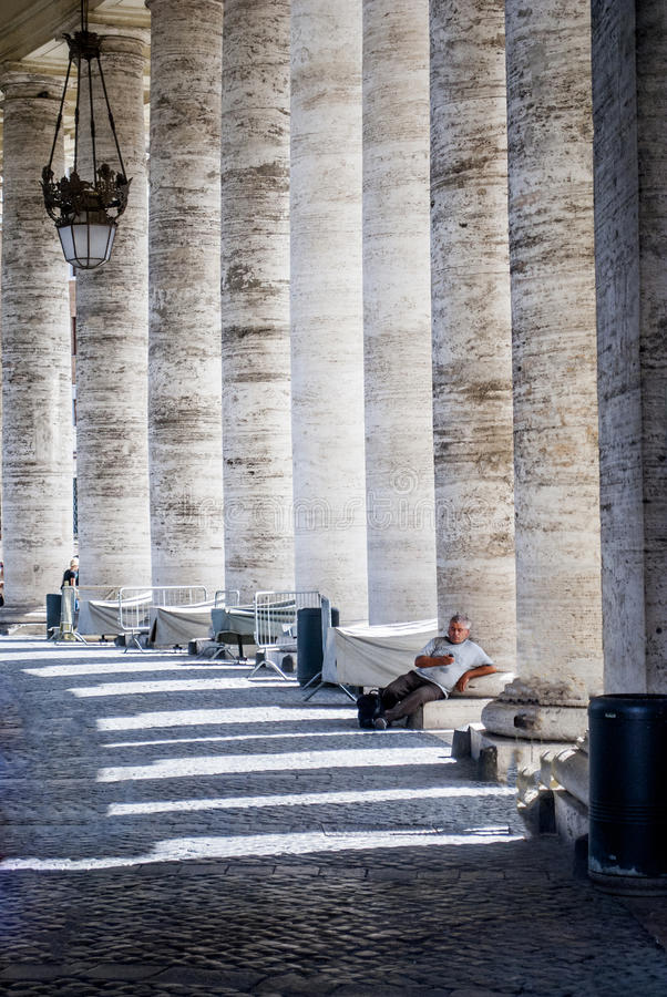Columned hallway in Saint Peter's Square. Vertical shot. stock image