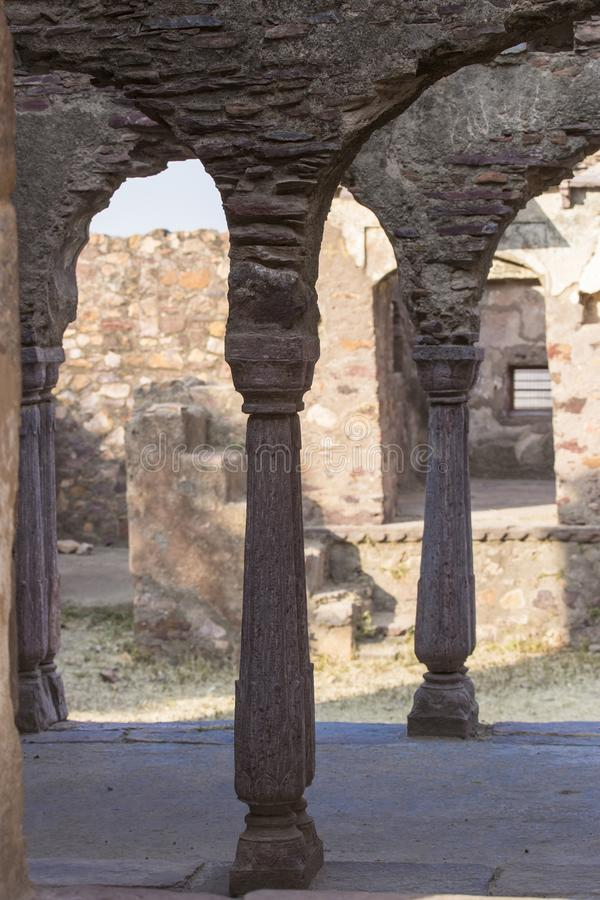 Columns and arches of the ancient Indian palace. Have collapsed from time, but look perfectly stock photography