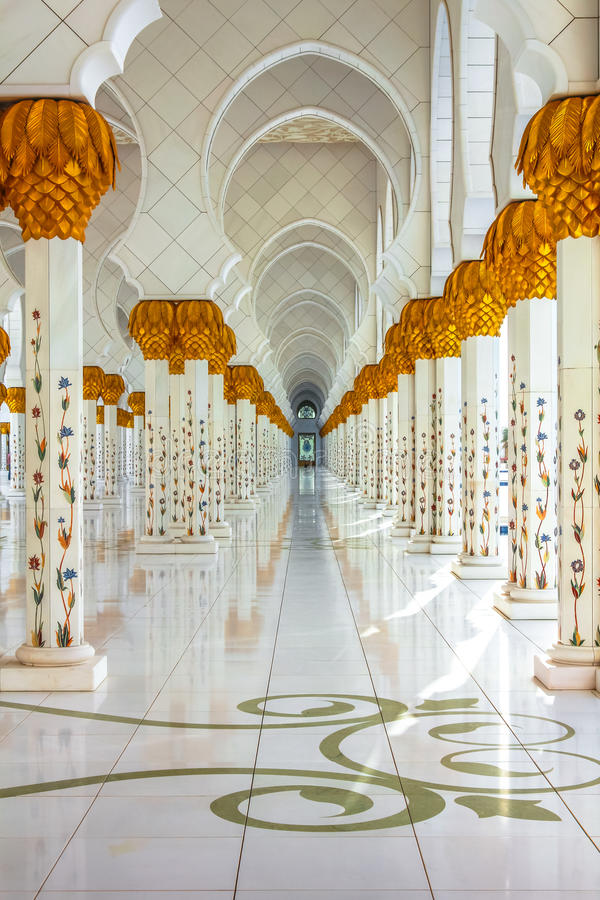 Columns background of Grand Mosque. Closeup of columns with decoration of Greek and Italian white marble. Sheikh Zayed Grand Mosque in Abu Dhabi, the largest royalty free stock photo