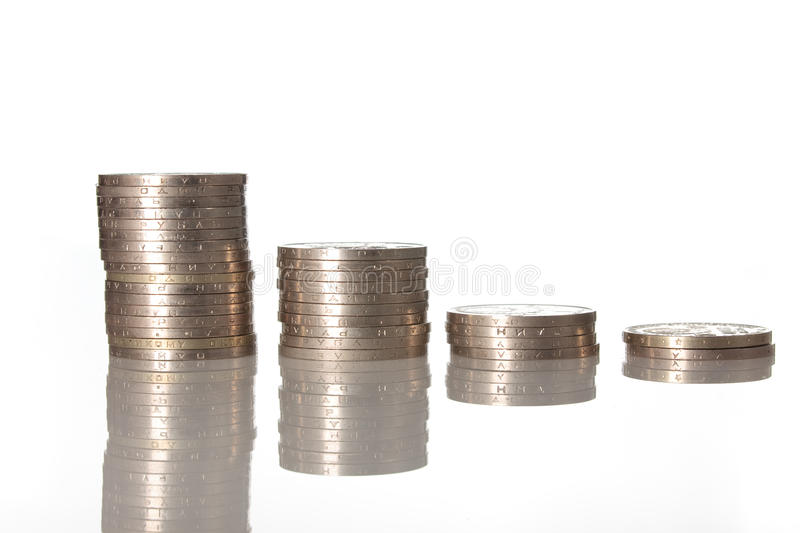 Columns of coins isolated on white color stock photography