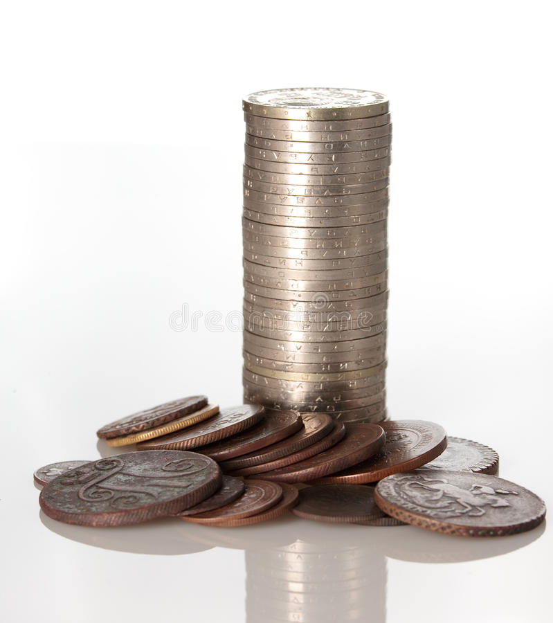 Columns of coins isolated on white color royalty free stock photos