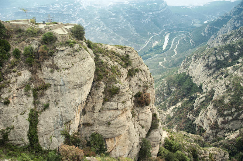 Columns of conglomerate rock stand out against the landscape at Montserrat royalty free stock image