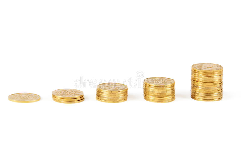 Columns of golden coins stock image