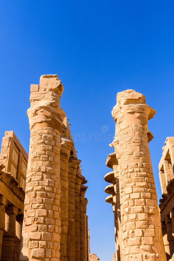 Columns in the great hypostyle hall of the Karnak temple. Columns in great hypostyle hall of Karnak temple royalty free stock photos