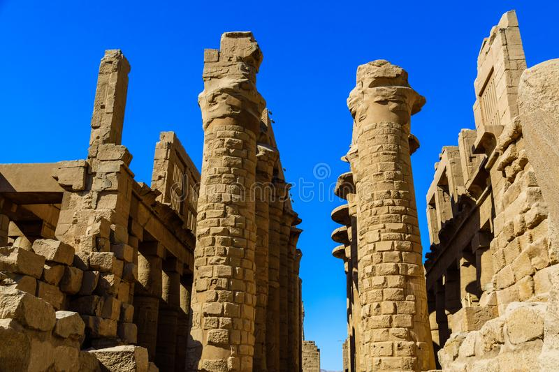 Columns in the great hypostyle hall of the Karnak temple. Columns in great hypostyle hall of Karnak temple royalty free stock image