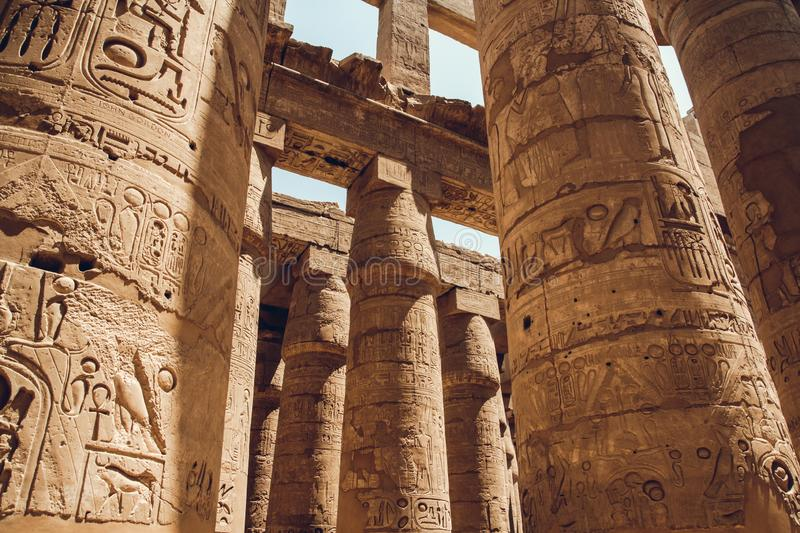 Columns with hieroglyphs in Karnak Temple at Luxor, Egypt. travel stock photos