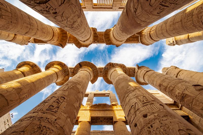 Columns of Karnak Temple in Egypt. Karnak Temple is one of Egypt best destinations for tourists and is situated in Luxor City, on the Nile, between Cairo and stock image