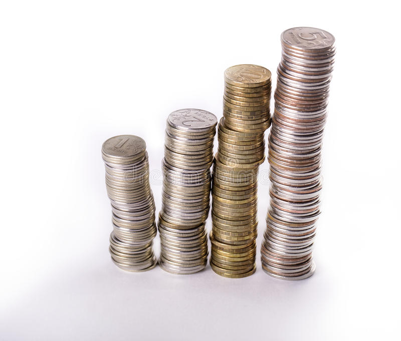 Columns from metallic currency. On white background royalty free stock photo