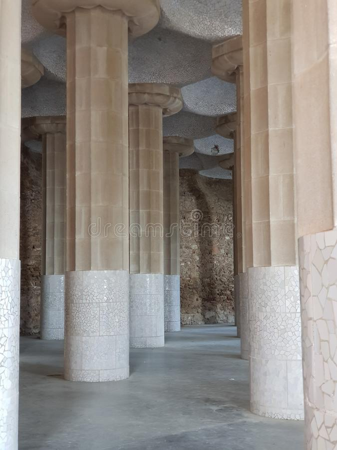 Columns in Park Guell, Barcelona,Spain. Gaudis, barcelonaspain, tourism, tourists, day, arcade, palm, trees, architects, stone, ceramics, shape, bank, pieces stock images