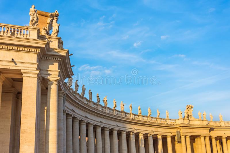 Columns in Saint Peter`s Square evening sunset light, Vatican.  royalty free stock photo