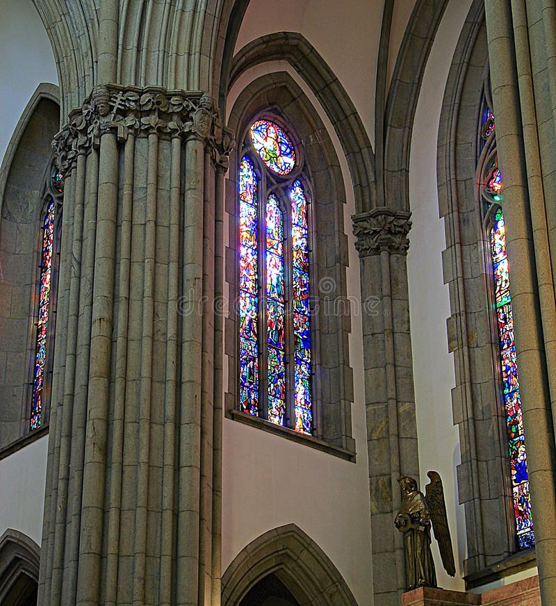The columns and stained glass of the cathedral. stock photos