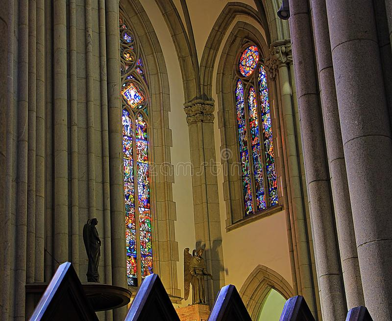 The columns and stained glass of the cathedral. stock photography