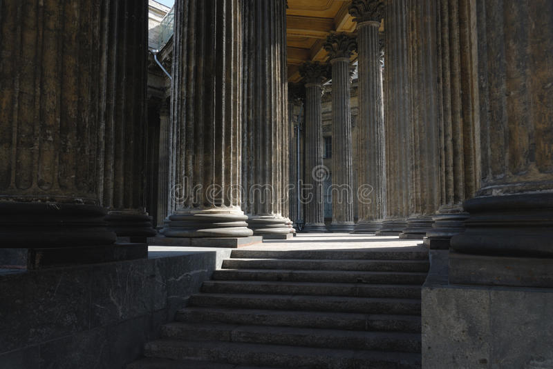 Columns and stair of old cathedral. Rows of fretted columns and stair of old Christian cathedral stock photos