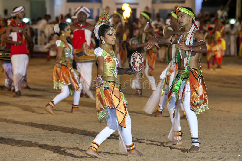Colurful dancers perform at the Kataragama Festival in Sri Lanka. The Kataragama Festival is a predominantly Hindu festival held each July or August commencing royalty free stock images