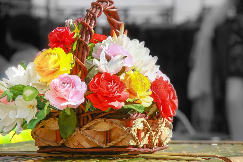 Colurful Roses in baskets stock photos