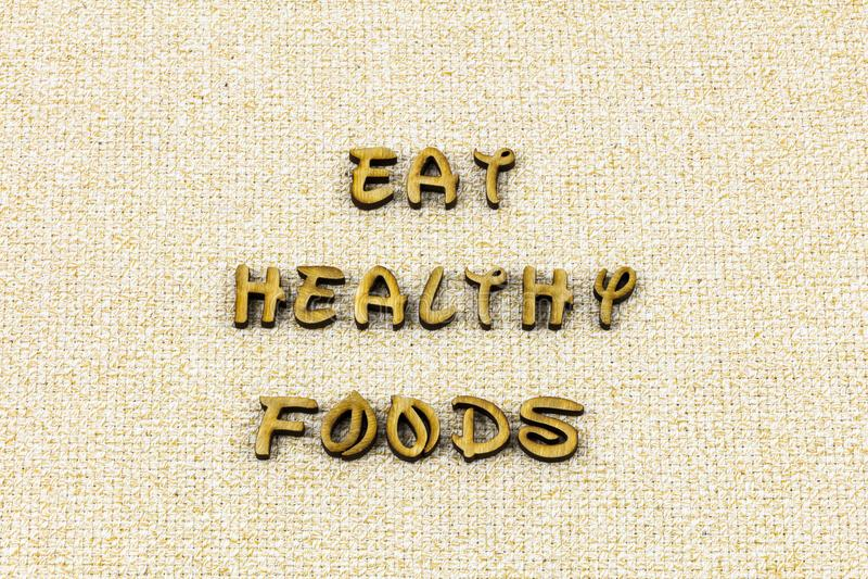 Coma o tipo fresco orgânico da tipografia da saúde saudável da dieta de alimento fotos de stock