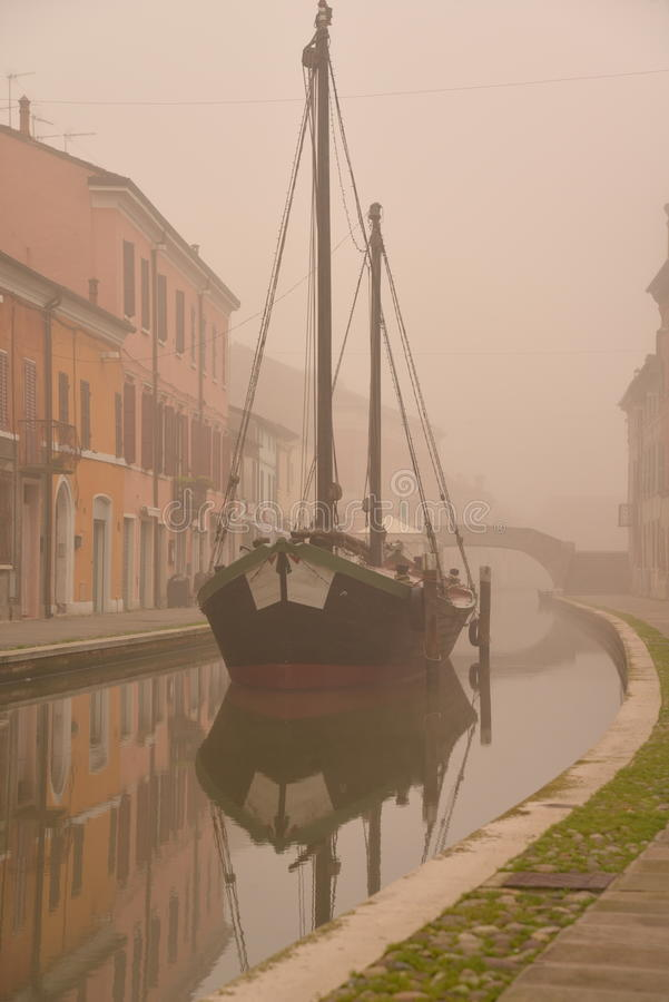 Comacchio, canal bridge and old ship in winter. Ferrara, Emilia Romagna, Italy stock images