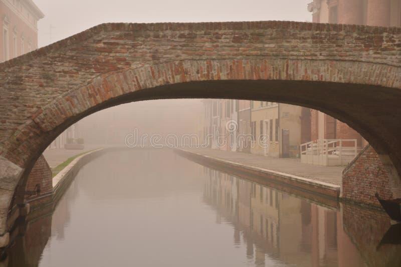Comacchio, canal bridge in winter. Ferrara, Emilia Romagna, Italy stock photos