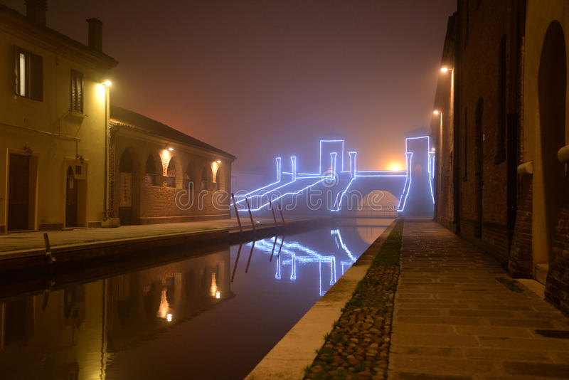 Comacchio, illuminated canal bridge in winter. Ferrara, Emilia Romagna, Italy stock image