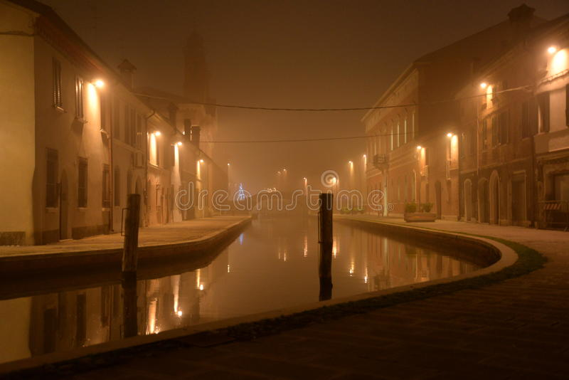 Comacchio, Italy. Night view of a canal. winter fog royalty free stock images