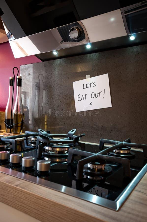 ¡Comamos hacia fuera! fotos de archivo