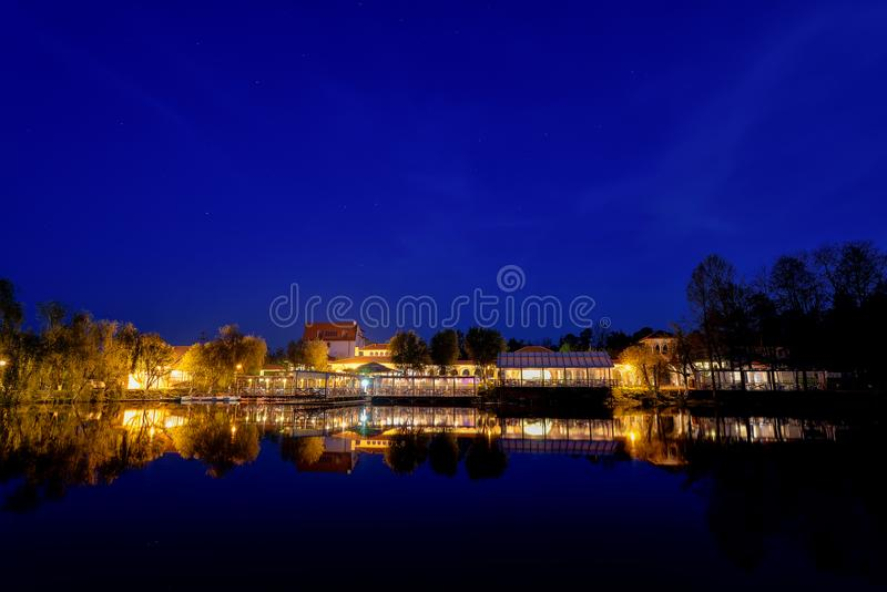 Comana lake touristic complex from Romania , Giurgiu county. Comana lake from Romania , Giurgiu county by night time at blue hour royalty free stock photo