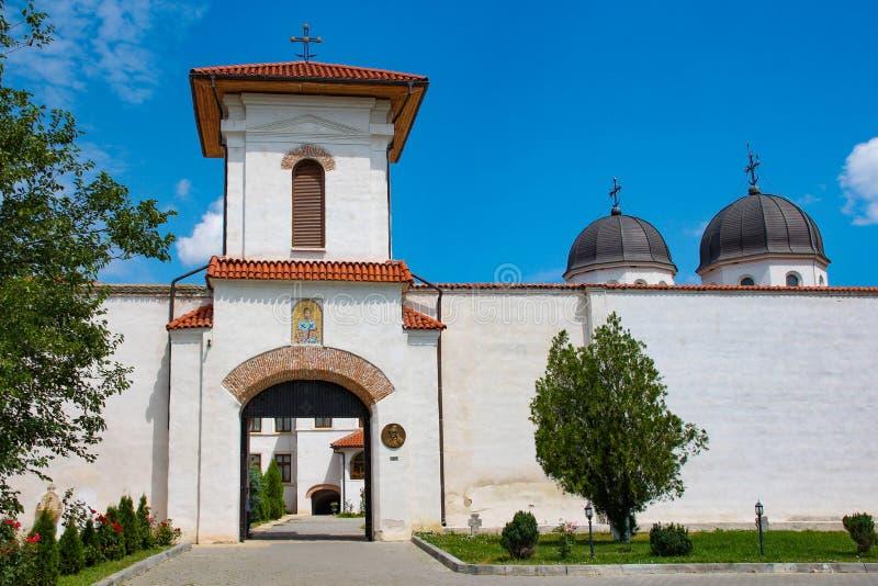 Comana Monastery entrance, in Giurgiu, Romania. Comana Monastery entrance, with domes visible over the wall. Located in Giurgiu county, Romania royalty free stock photography