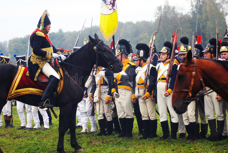 Comandante e soldati dell'esercito fotografia stock