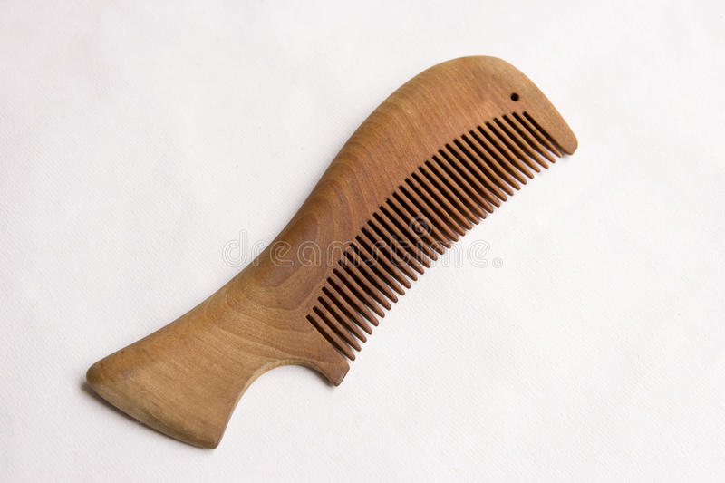Comb. Single wooden comb on white background stock photography