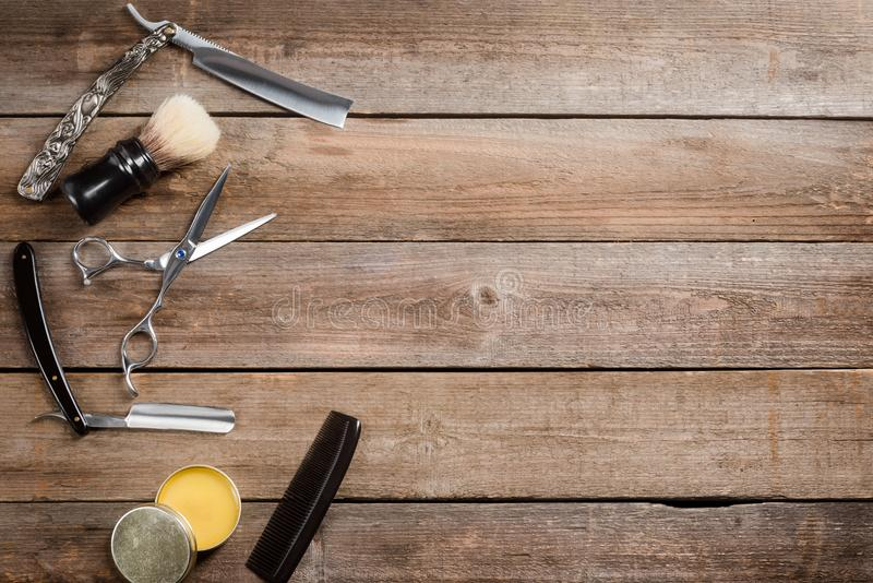 Comb, wax and straight razors royalty free stock images