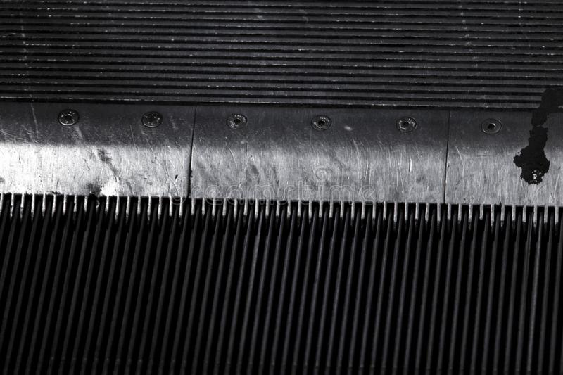 Comb detail of a heavily used metro elevator. royalty free stock photos