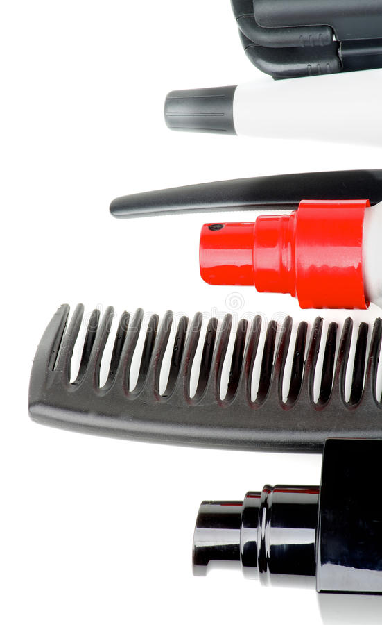 Comb and Hair Styling Products. Frame of Black Comb and Various Hair Styling and Curling Products isolated on white background royalty free stock photo