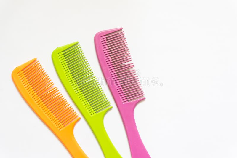Comb icon. Orange, green and pink icon isolated on white background stock photography