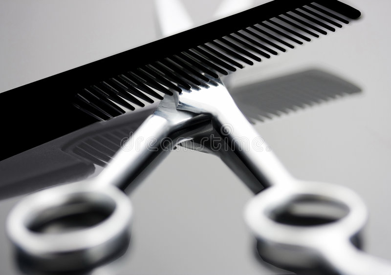 Comb and scissors. Cosmetologist shears and black comb with reflection royalty free stock images