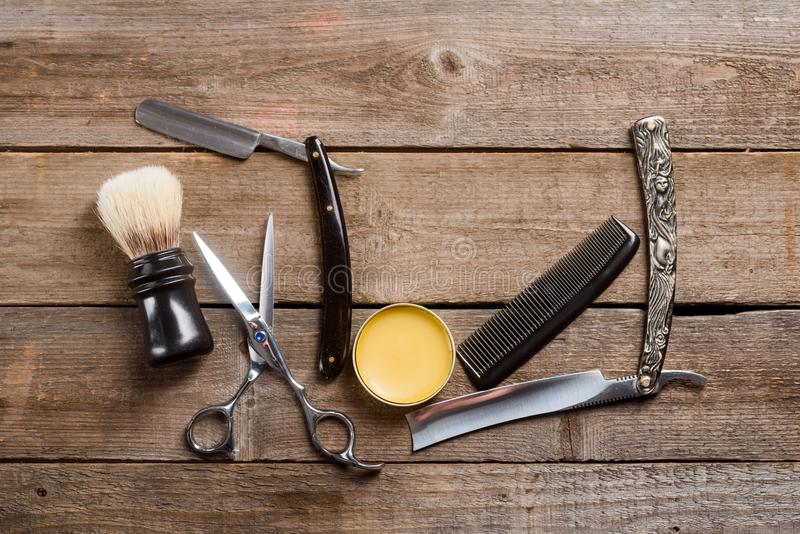 Scissors, wax and comb stock images