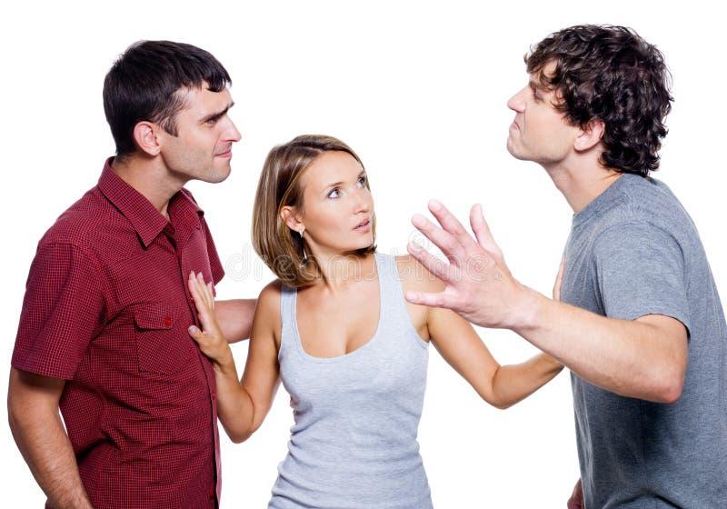 Combat d'hommes pour le femme photo stock
