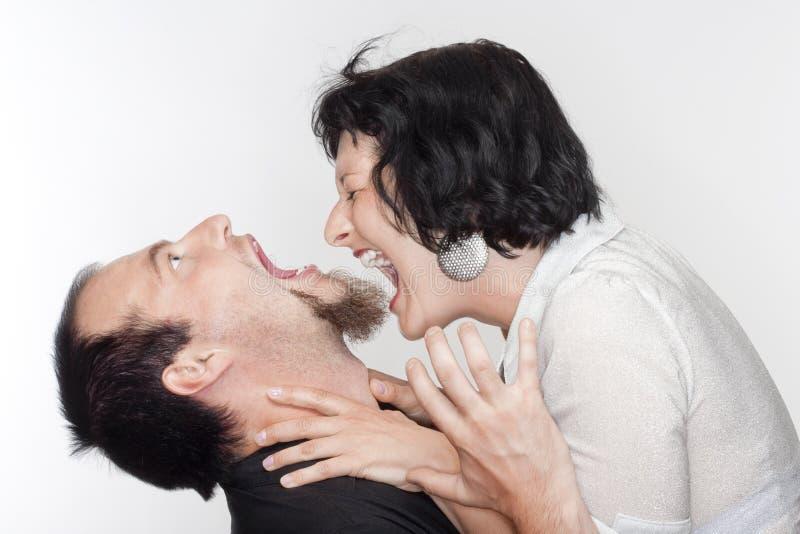 Combat de couples photographie stock