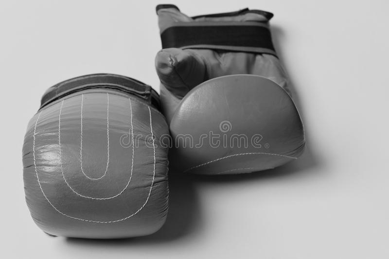 Combat and fight concept. Pair of boxing gloves lying next to each other. stock image
