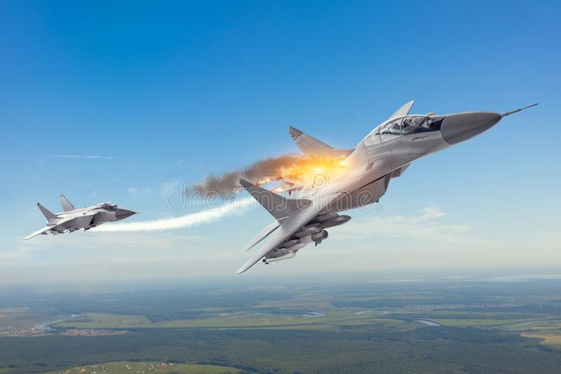 Combat fighter launched a homing missile and explosion hit a target with another plane jet. Conflict, war. Aerospace forces.  royalty free stock images
