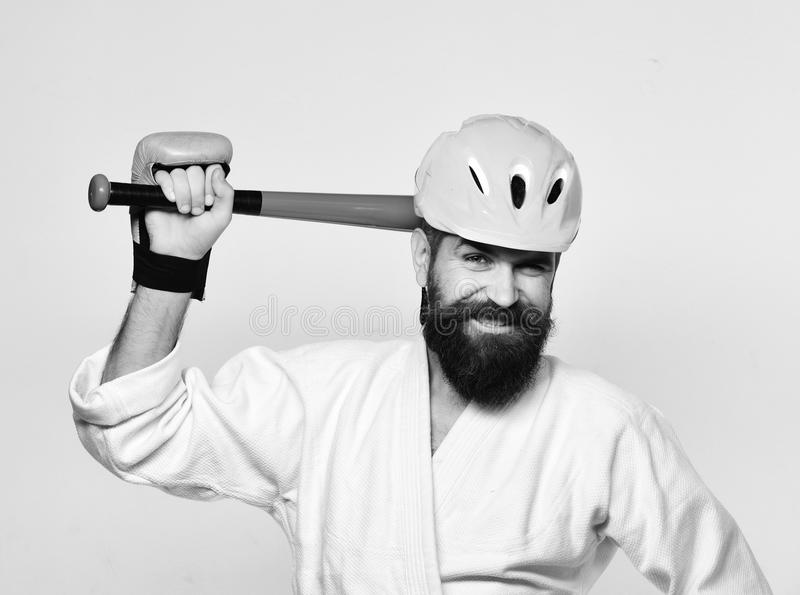 Combat master gets ready to fight. Karate man with smile royalty free stock photo