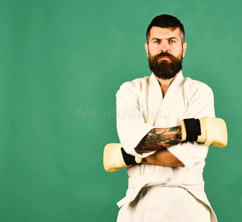 Combat master holds hands crossed working out. stock photography