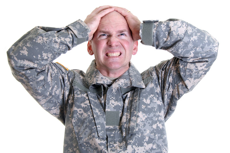 Combat Stress. An American soldier in the new digitized camouflage uniform having problems with combat stress or post traumatic stress disorder stock photos