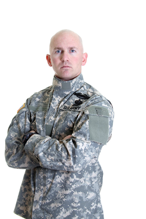 Combat Veteran. An American soldier in the new digitized camouflage uniform with Combat Infantry Badge, Jump Master wings, and Air Assault Badge royalty free stock photos