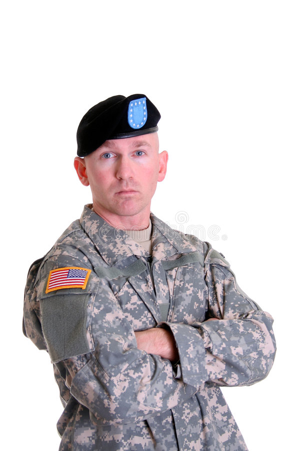 Combat Veteran. An American soldier in the new digitized camouflage uniform with Combat Infantry Badge, Jump Master wings, and Air Assault Badge stock images
