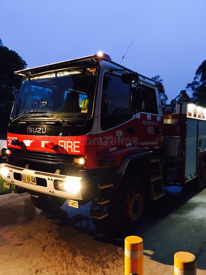 Combatiente del coche de bomberos caliente imagen de archivo